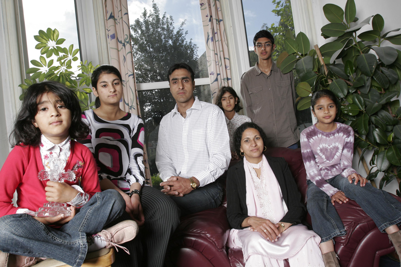 From left to right, Leena, Anniesa, Nissar, Sarah, Kubra, Issar, and Miriam Hussain, a Christian family who have been threatened with death for converting from Islam in West Yorkshire, England.