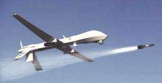 A US predator drone fires a hellfire missile.