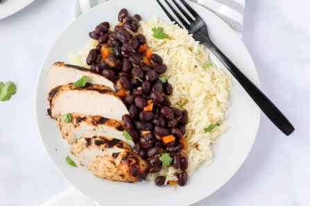 Beans and rice with sliced grilled chicken