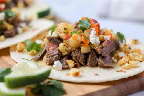 Grilled steak and elote tacos.