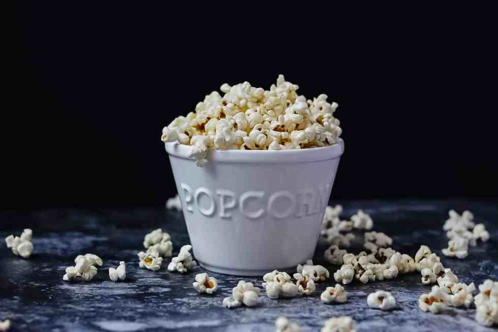 brown butter popcorn in ceramic popcorn bowl