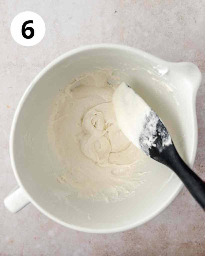 macaron batter flowing into figure 8