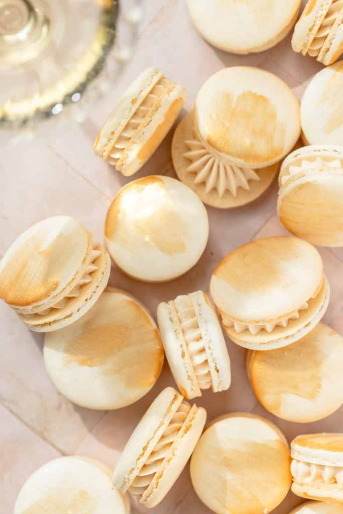champagne macarons with edible gold paint