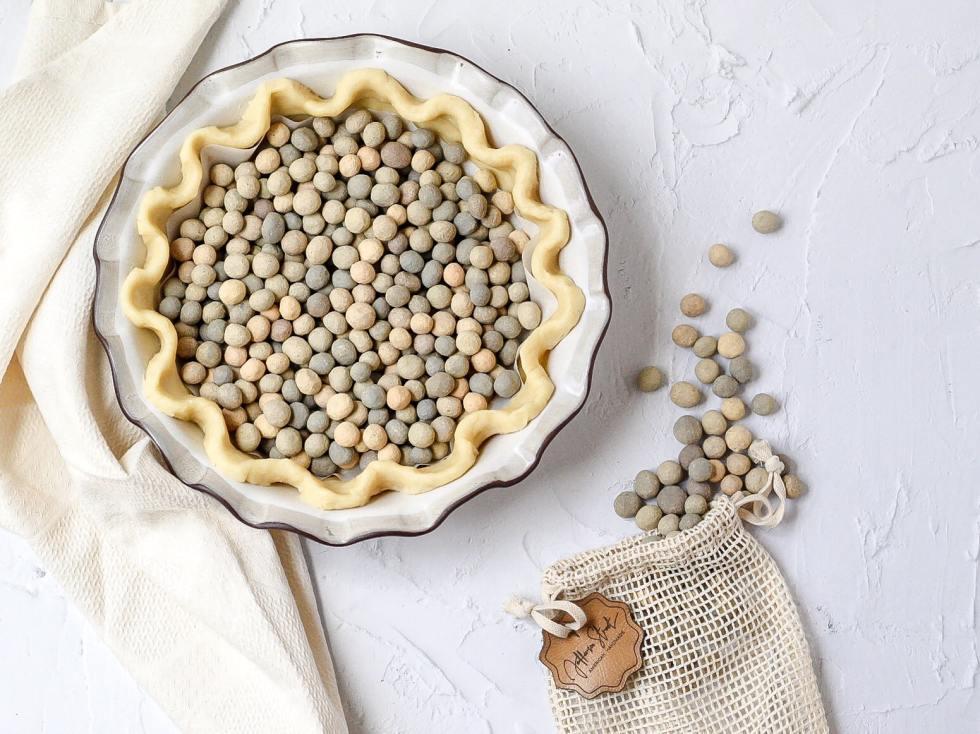 uncooked pie crust filled with Jefferson Street Ceramics pie weights