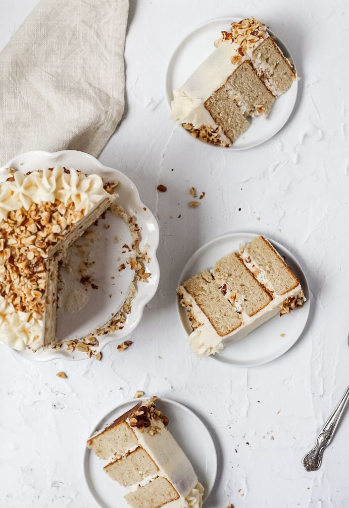 slices of brown butter hazelnut layer cake on small plates