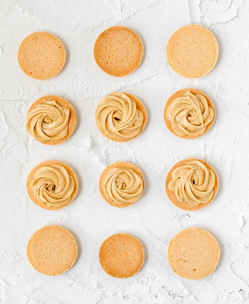 pumpkin spice french macarons with pumpkin cream cheese filling