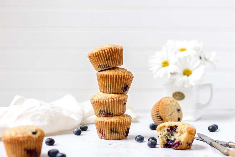 brown butter blueberry muffins in a stack