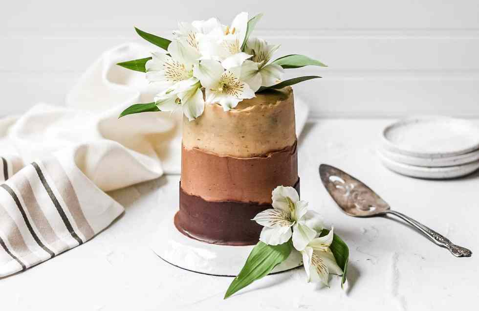 chocolate espresso ombre layer cake topped with fresh flowers
