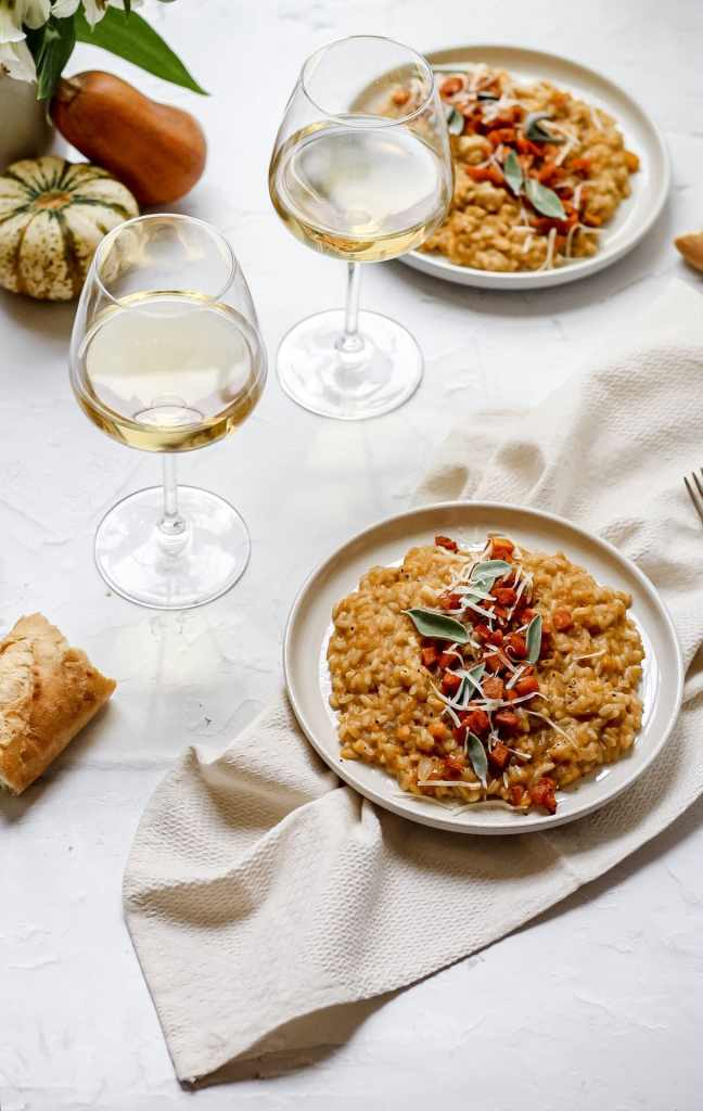 roasted butternut squash risotto topped with honeynut squash and served with white wine