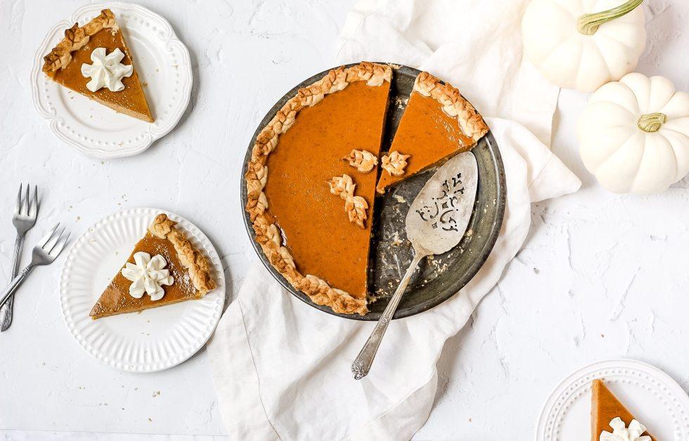 bourbon pumpkin pie with slices cut out