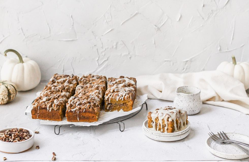 brown butter pumpkin spice coffee cake with drizzled glaze on top