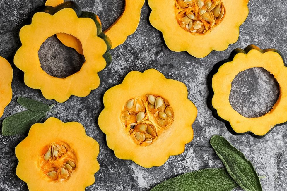 raw acorn squash sliced in rings