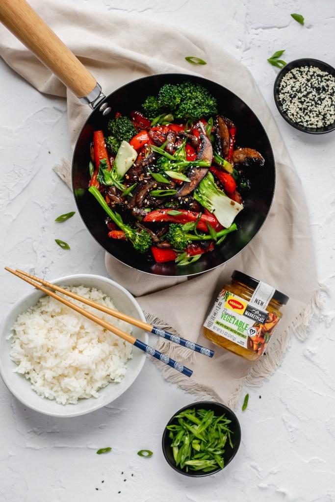 vegan mushroom stir fry with peppers, bok choy, and broccoli