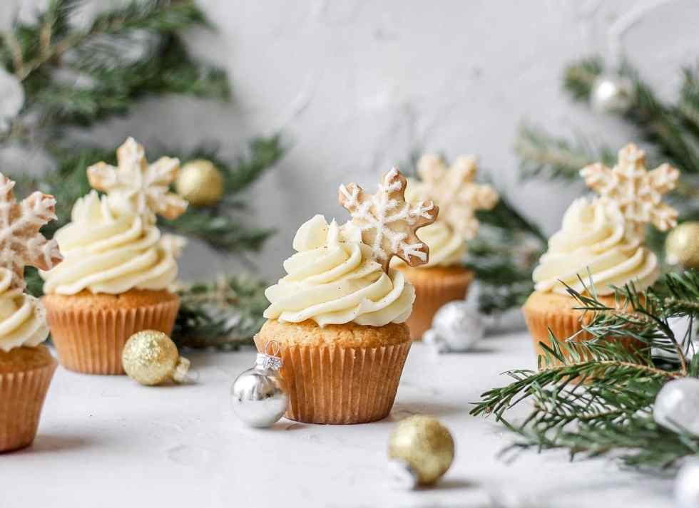 bourbon eggnog cupcakes with eggnog buttercream and topped with a christmas cookie