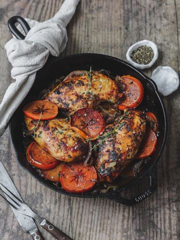 harissa and persimmon chicken in cast iron skillet