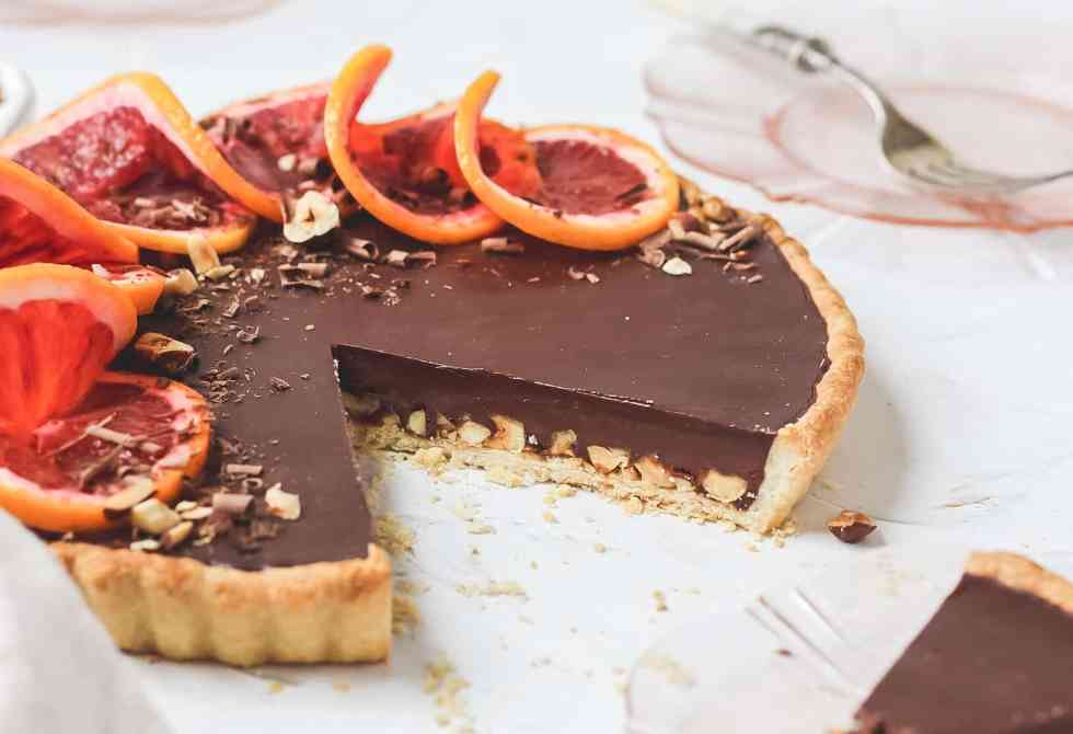 cut piece of chocolate tart