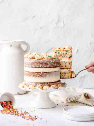 funfetti birthday cake with slice missing. milk bar copycat