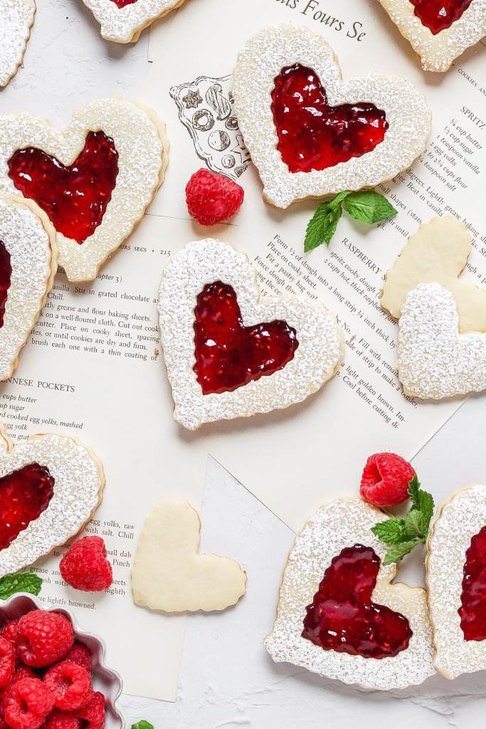 heart shaped linzer cookies filled with raspberry jam