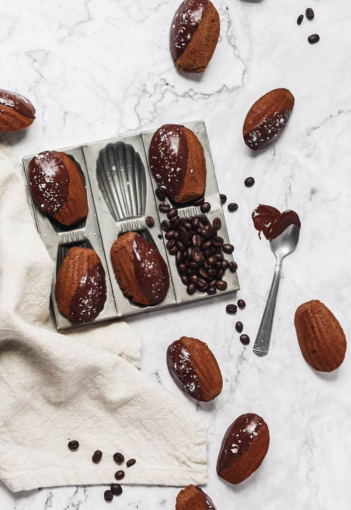 chocolate espresso madeleines in madeleine pan with flaky sea salt