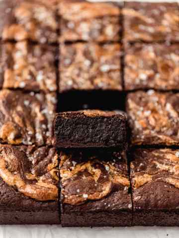 halva brownies with one piece showing chewy center