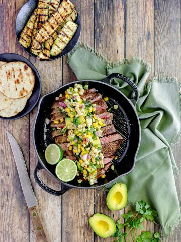 flank steak with corn and avocado salsa on top