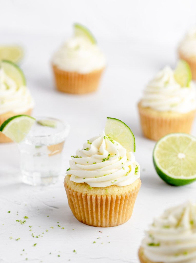 close up of margarita cupcakes with tequila shot