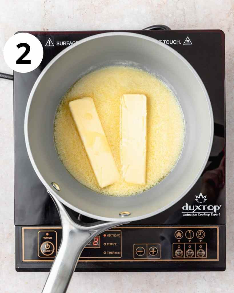 sticks of butter melting in a pot