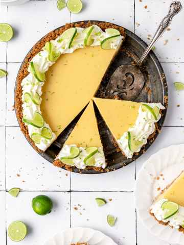 close up of key lime pie with slices cut