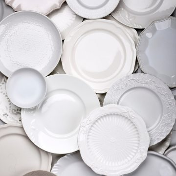 close up shot of a bunch of different plates for food photography