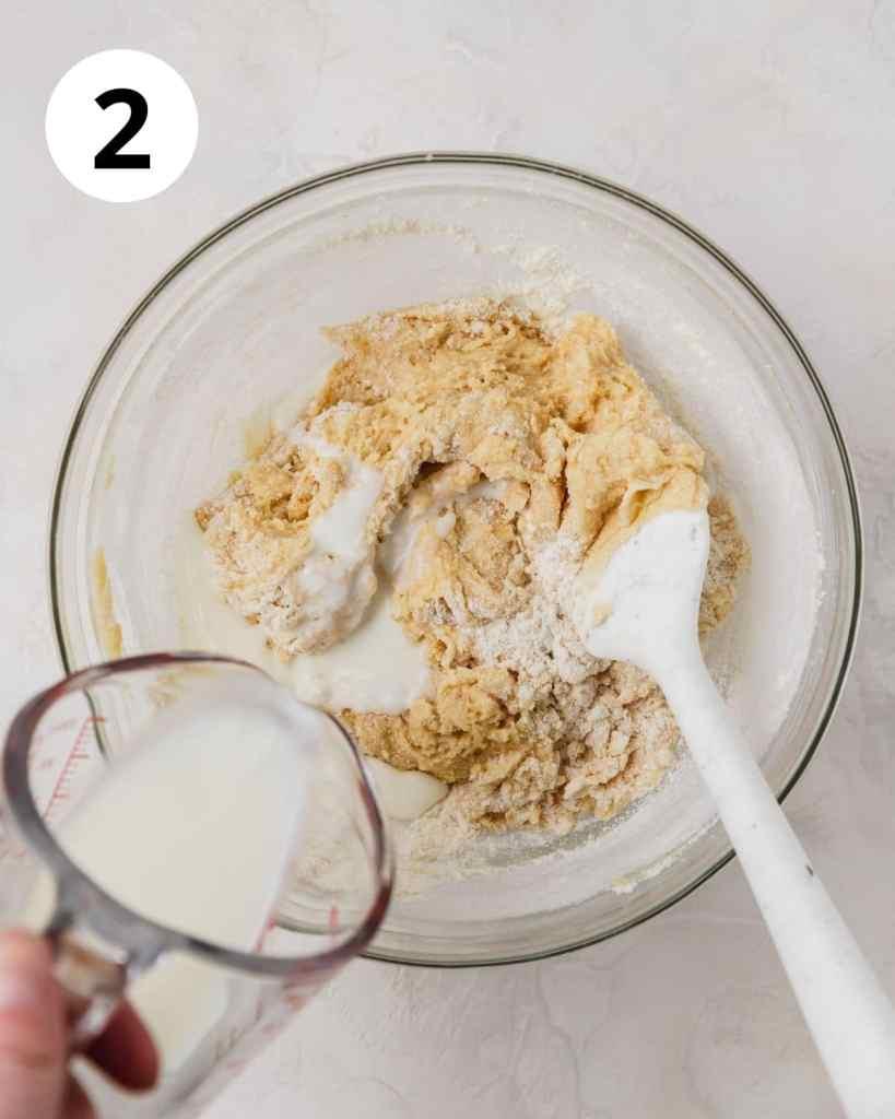 adding milk to flour mixture