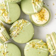 pistachio macarons with white chocolate ganache and chopped pistachios