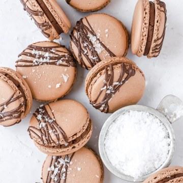 close up shot of chocolate sea salt macarons