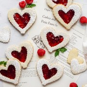 close up shot of heart shaped raspberry linzer cookies