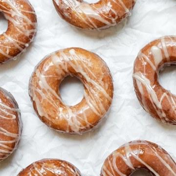 close up shot of sourdough donuts with vanilla bean glaze