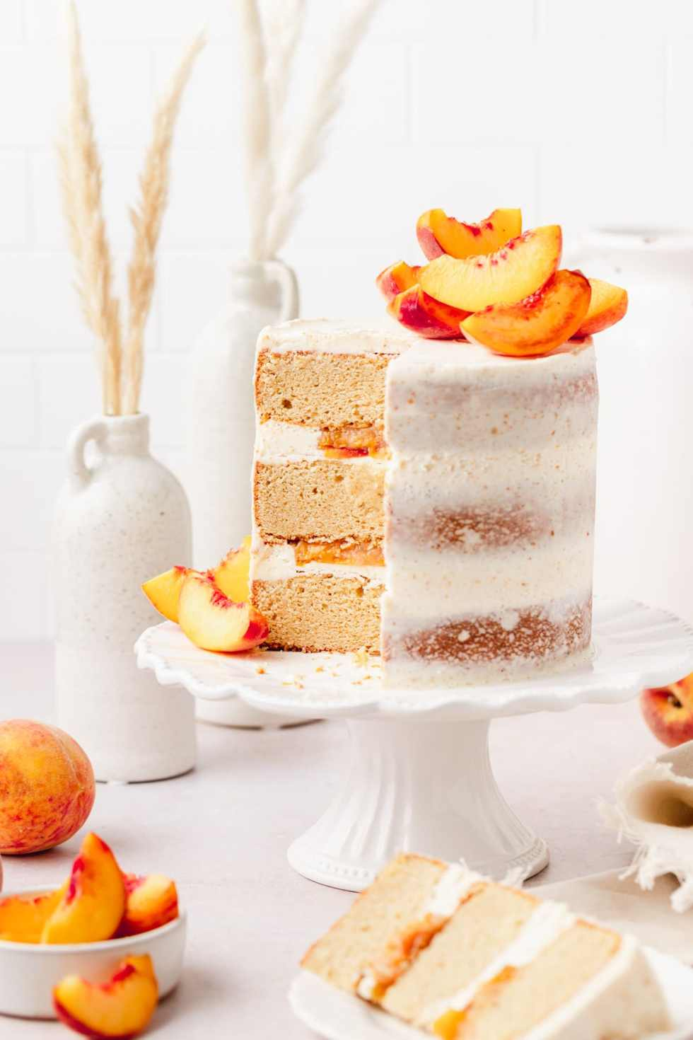 brown butter peach layer cake with slice cut out