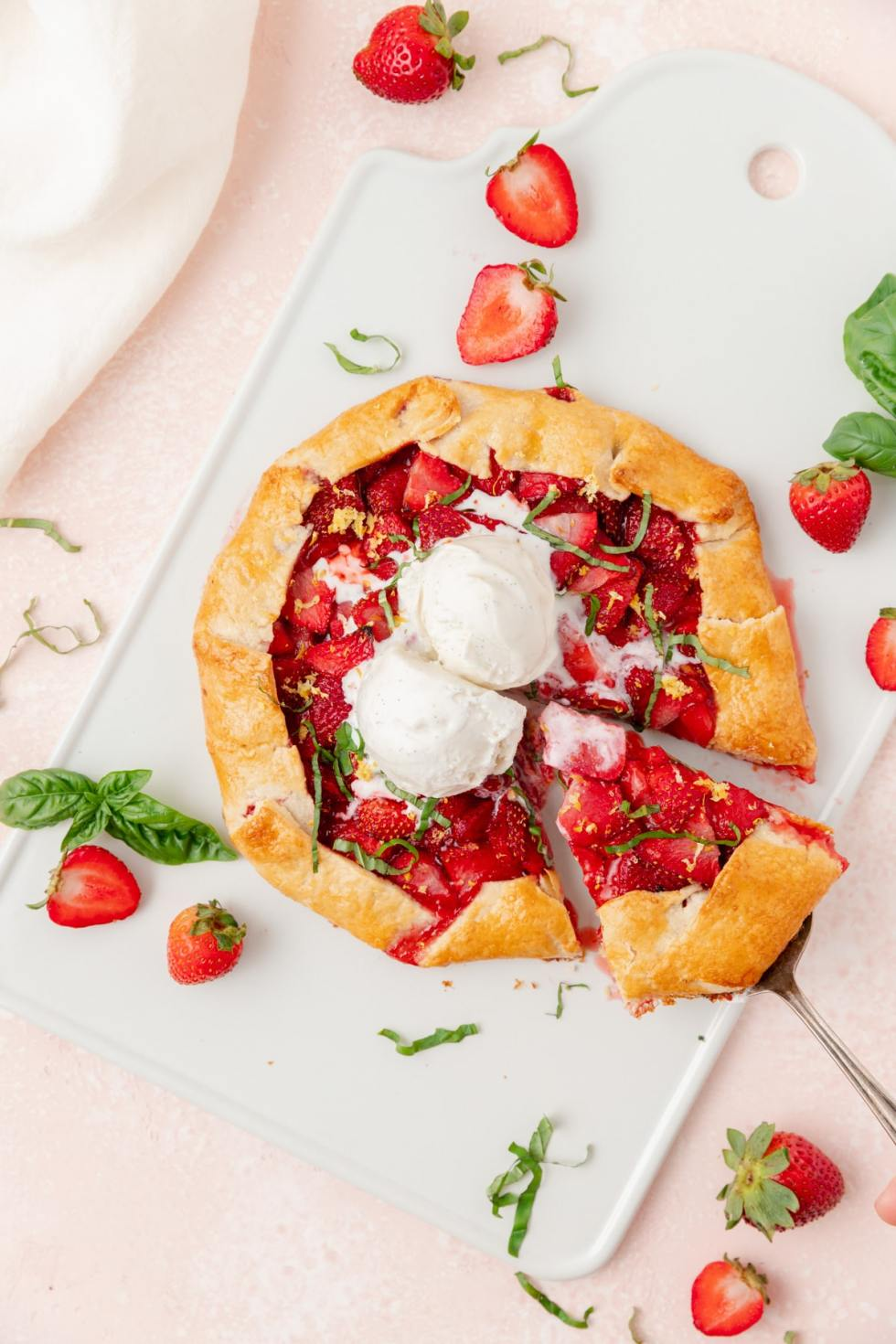 strawberry basil galette with piece being pulled out