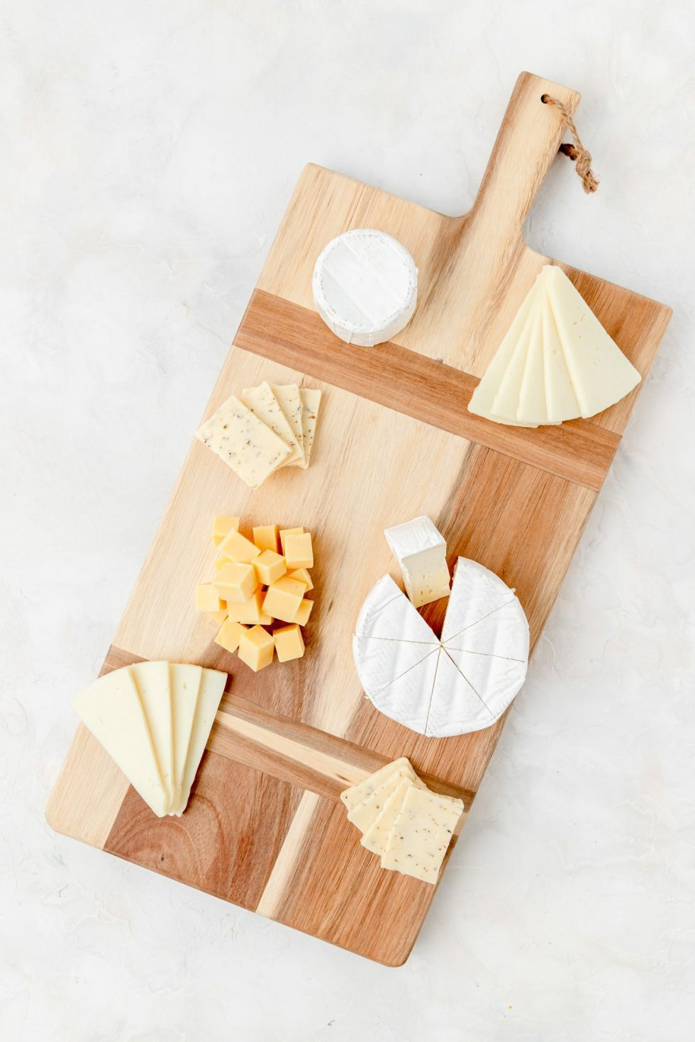 just sliced cheese on a board