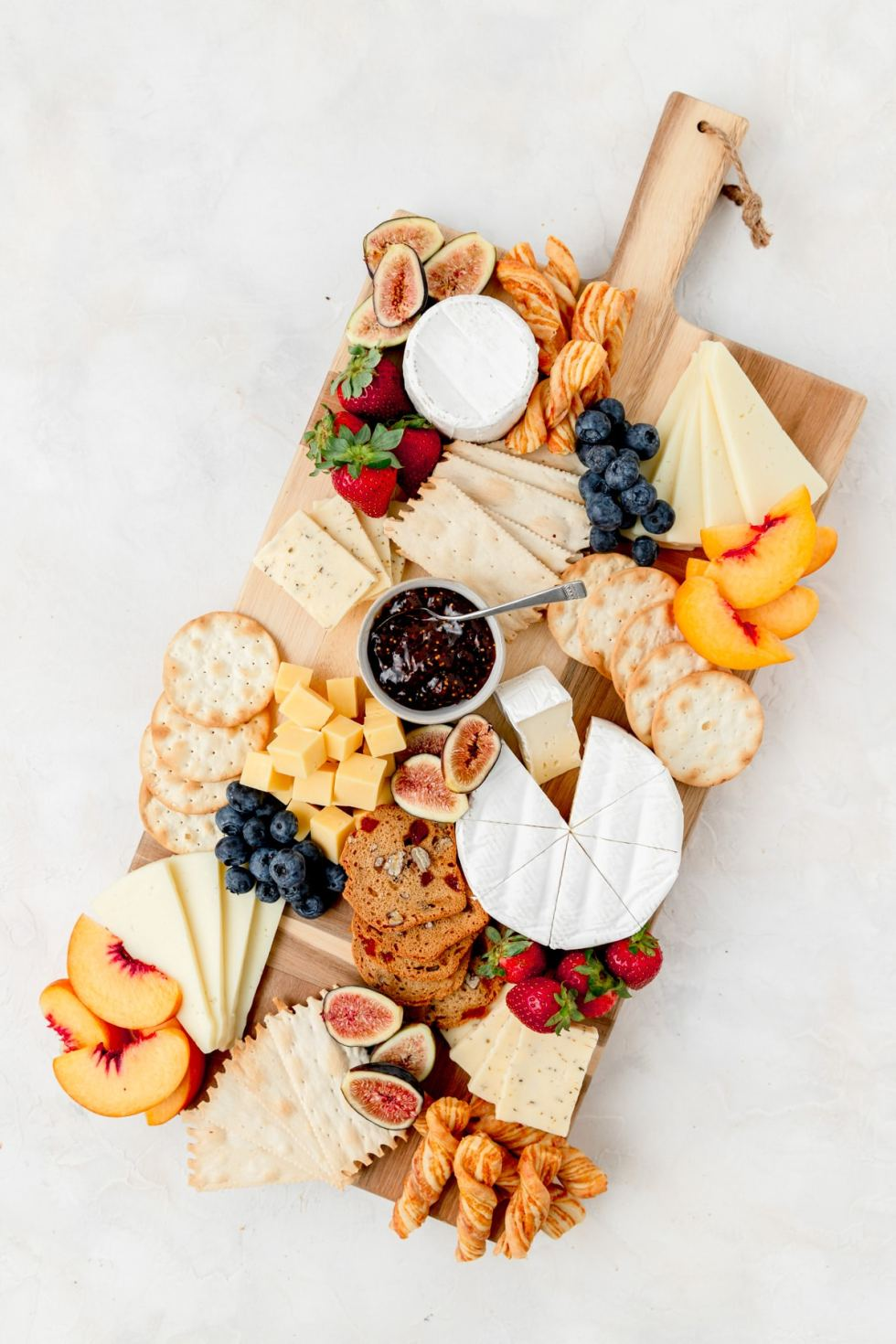 adding fruit to the cheeseboard
