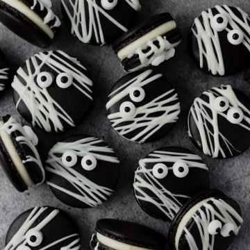 close up shot of black cocoa mummy macarons