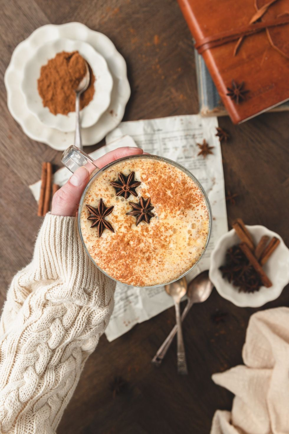 hand holding pumpkin spice latte
