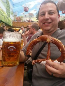 Ceetar with half a giant pretzel and a beer at Oktoberfest