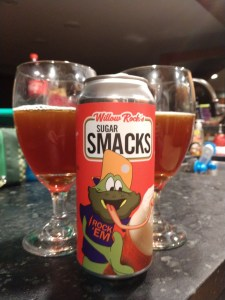 Pickture of 'Sugar Smacks' beer with a frog, and an amber beer behind it