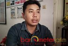 TUNGGU SIDANG: Rustamaji Yudika, korupsi dana hibah KPU Lamongan tunggu persidangan. | Foto: Barometerjatim.com/HAMIM ANWAR