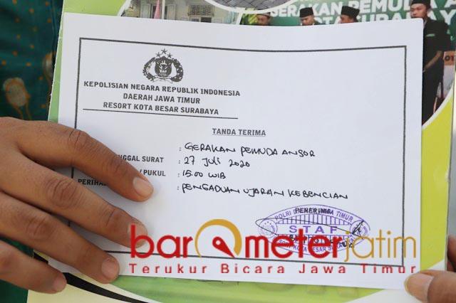 BERKAS DITERMA: Ansor Surabaya laporkan akun FB Zakaria Al Anshori usai tiga kali tabayyun.   Foto: Barometerjatim.com/ ROY HS