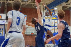 vs. NH 1 10 18 2 300x200 Freshman Jeremiah Davis makes a slam dunk in varsity basketball