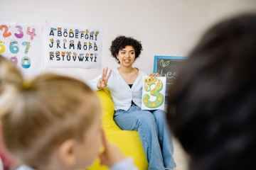 a woman teaching kids