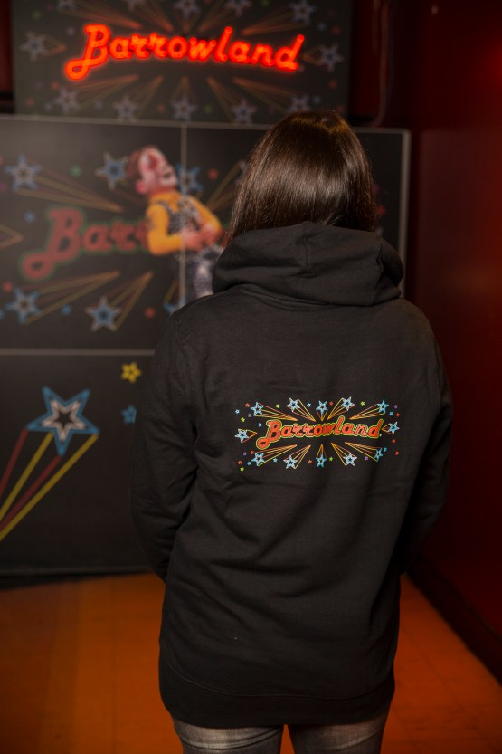 Lady with back to camera showing back print of black barrowland hooded top