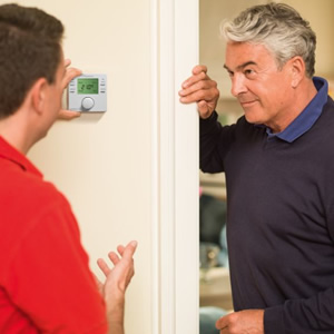 An engineer explaining the heating controls