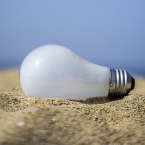 Light Bulb on Beach Sand