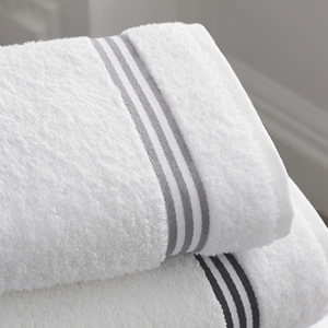 Crisp white folded bath towels